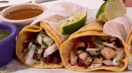 Mexican-style tacos with steak, chicken and chorizo at