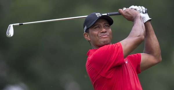 Tiger Woods watches his shot from the third