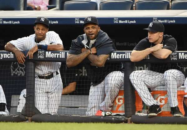 New York Yankees pitcher CC Sabathia, center, looks