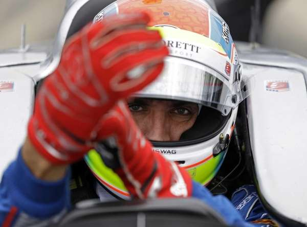 Justin Wilson puts on his gloves as he