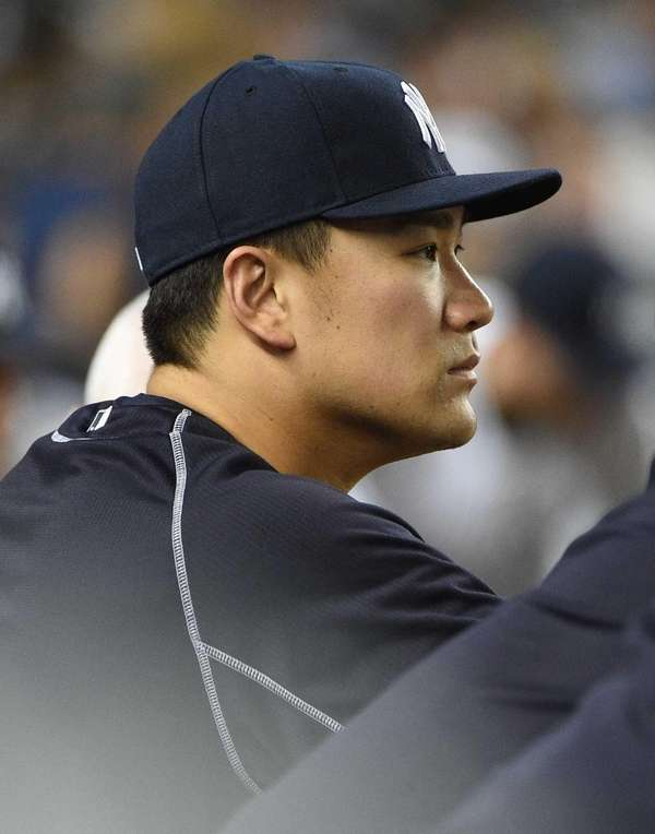 New York Yankees pitcher Masahiro Tanaka looks on
