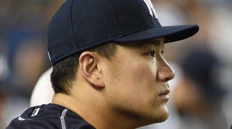 New York Yankees pitcher Masahiro Tanaka looks on