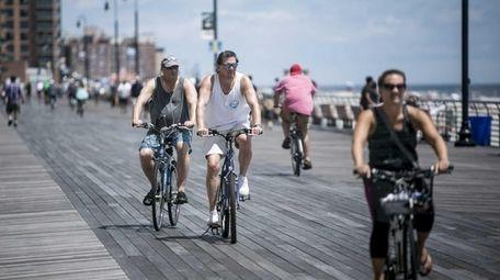 People enjoy the Long Beach boardwalk on June
