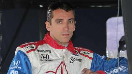 Justin Wilson waits to qualify before the second
