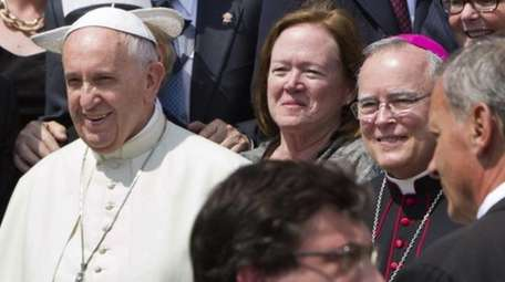 Philadelphia's Archbishop Charles Chaput, right, stands next to