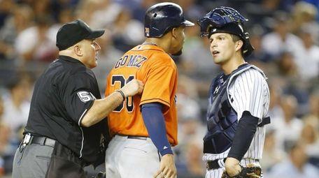 Carlos Gomez of the Houston Astros has words