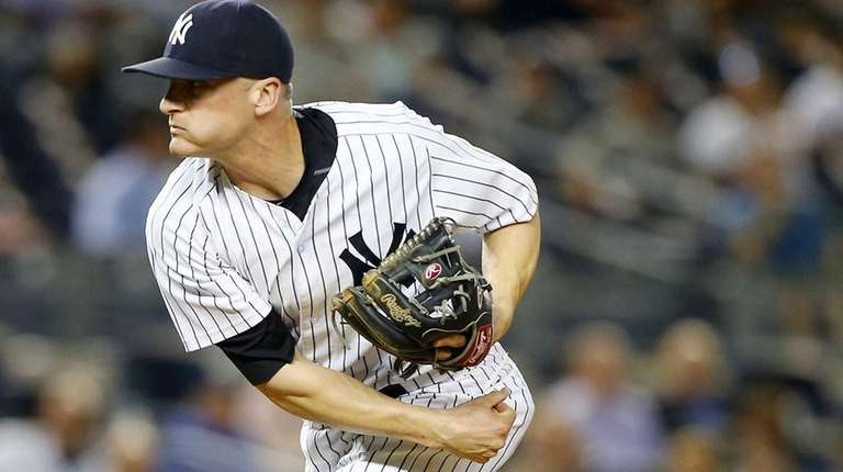 Brendan Ryan of the New York Yankees pitches