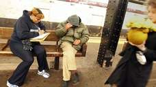 Volunteer Vanessa Thompson (L) interviews a homeless