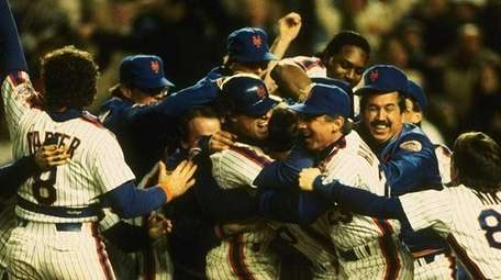 The New York Mets celebrate after an 8-5