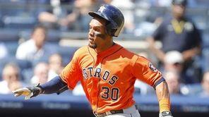 Carlos Gomez #30 of the Houston Astros scores