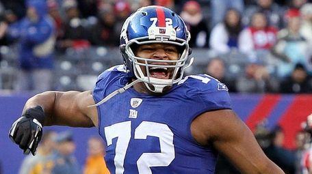 Osi Umenyiora of the New York Giants celebrates