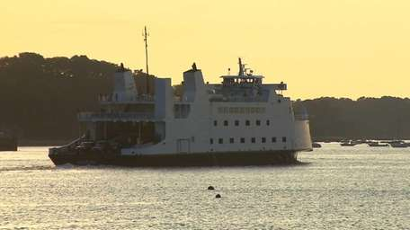 Port Jeff ferry at sunset ahead of an