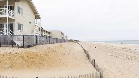 A series of fences and sand berms along