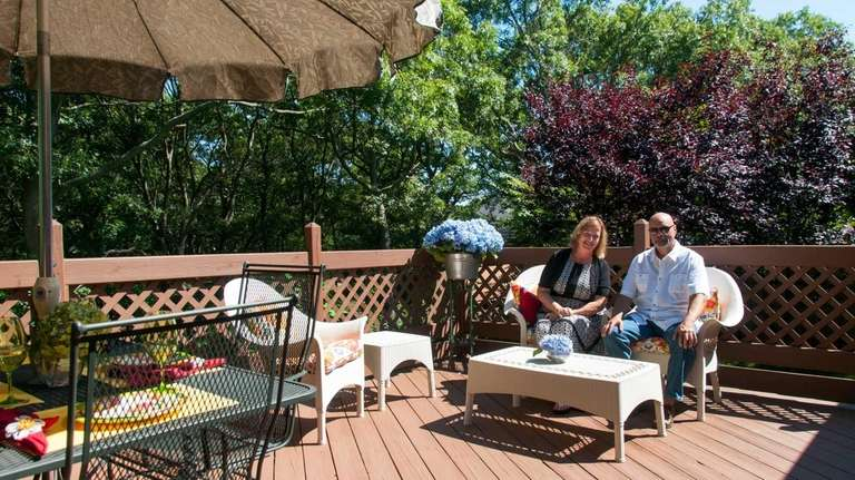 Vincent and Kathleen Taravella sit on their patio