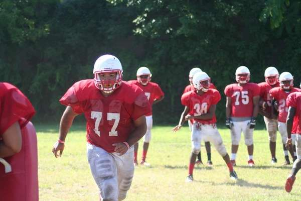 Freeport offensive lineman Max Garcia practices during training