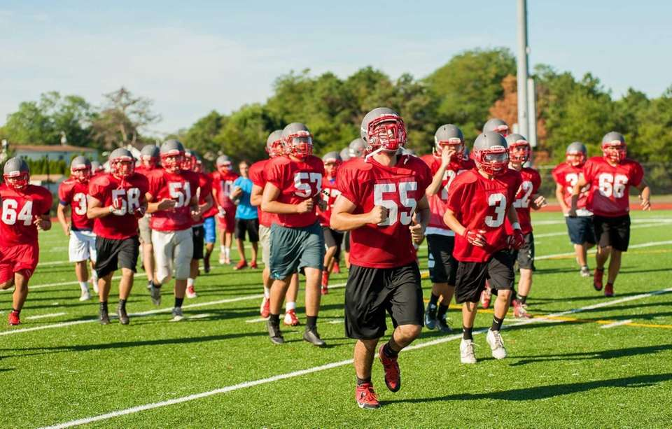 Members of the Connetquot football team run off