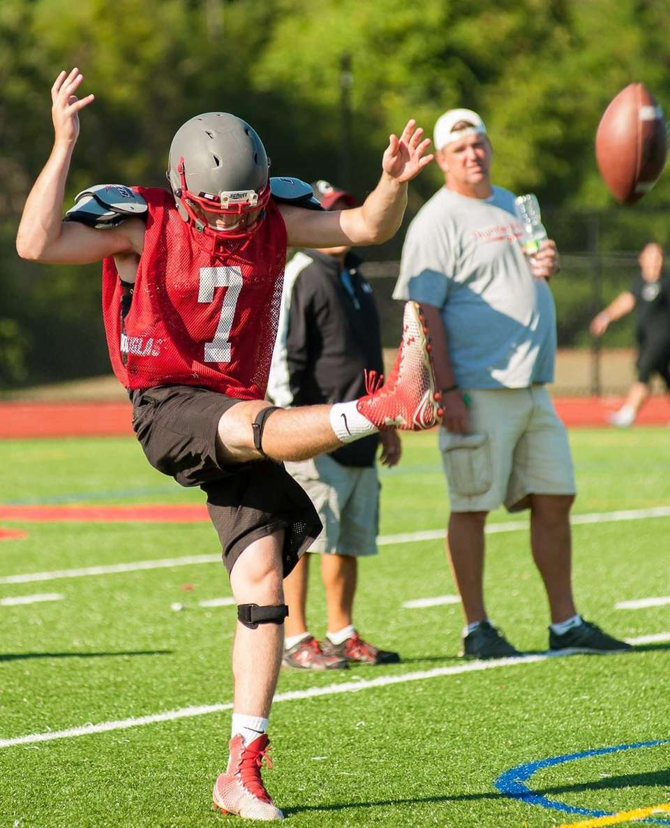 Connetquot's Jack Cassidy punts the ball during practice