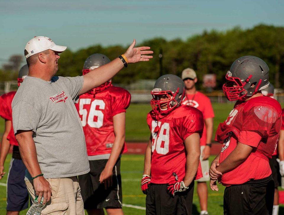 Connetquot head football coach Mike Hansen addresses his