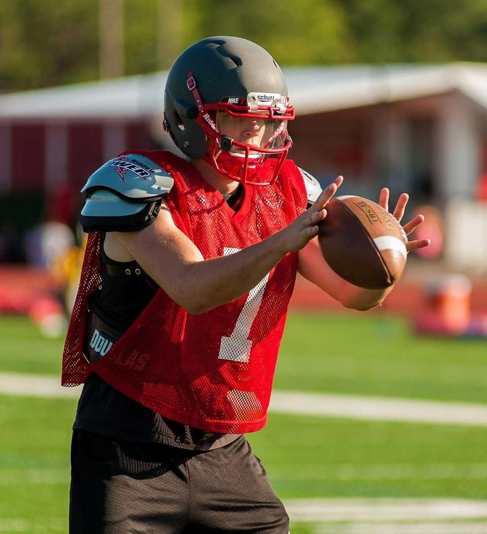 Connetquot's Jack Cassidy takes a snap during practice