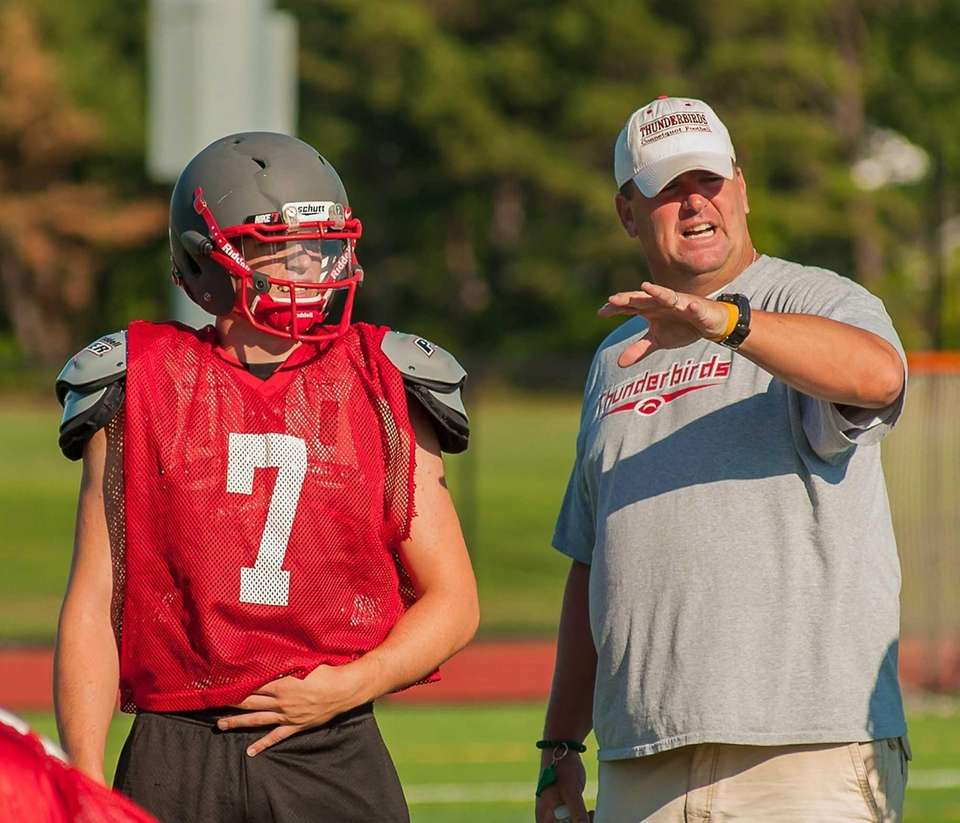 Connetquot's Jack Cassidy, left, and head coach Mike
