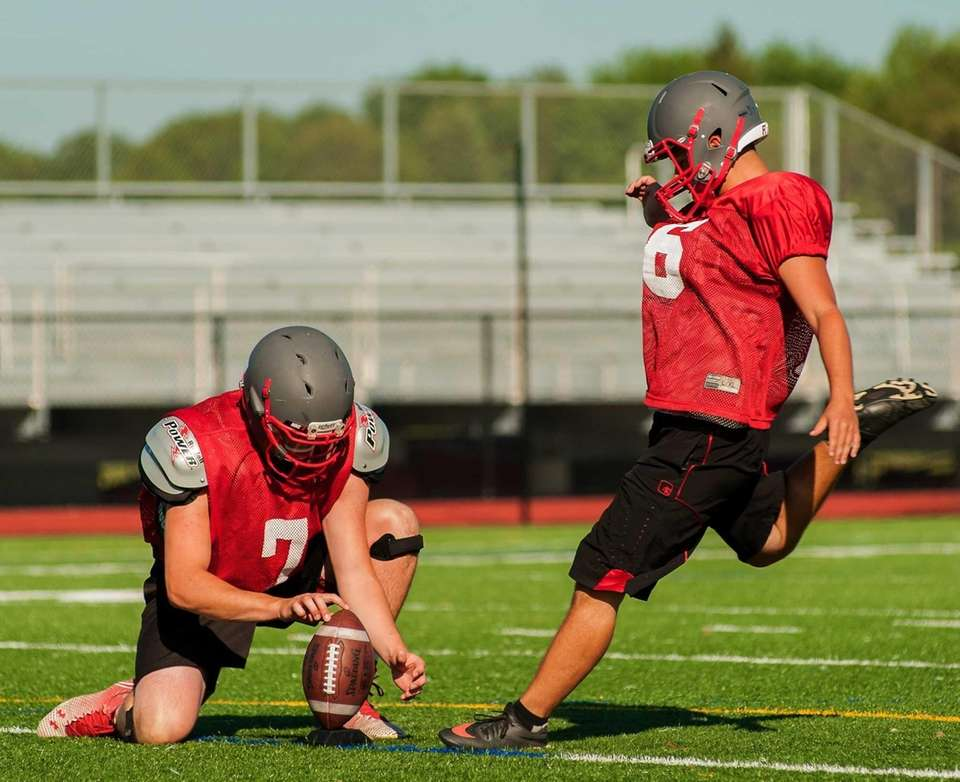 Connetquot's Jack Cassidy, left, holds the ball as