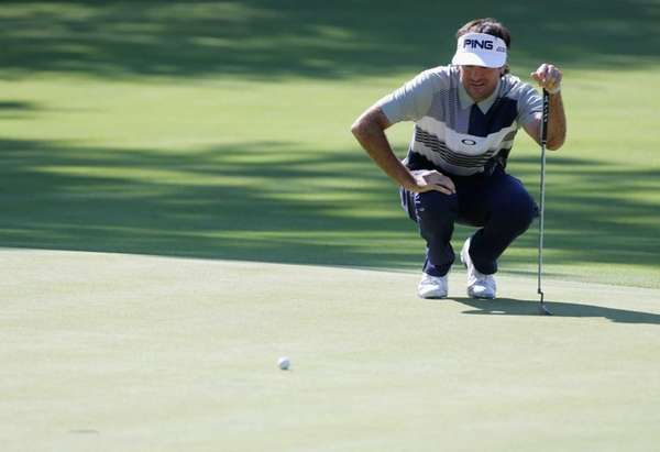 Bubba Watson lines up a putt during the
