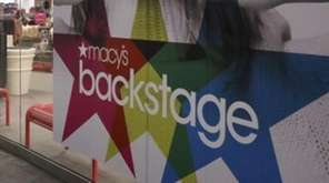 A shopper walks past the Macy's Backstage store