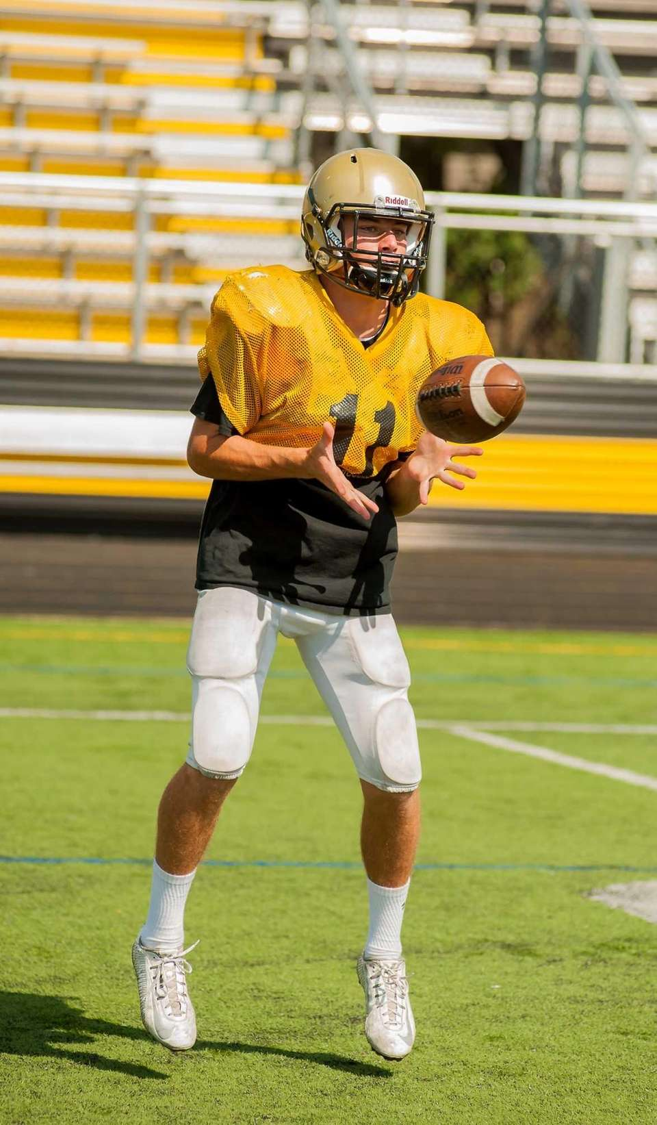 Wantagh's Dylan Beckwith takes a snap during practice