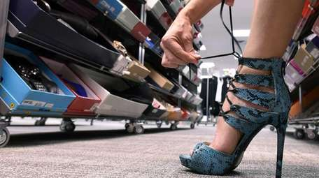 A woman tries on a pair of shoes