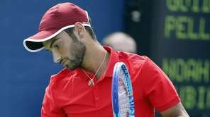 Noah Rubin reacts during his qualifying match with