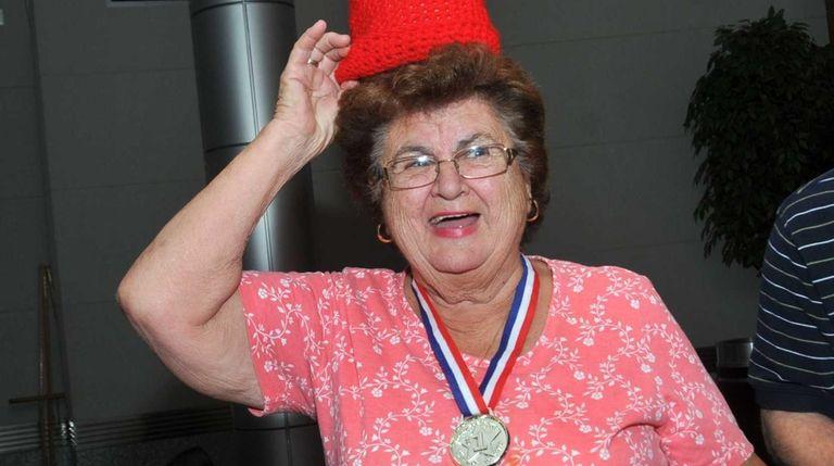 Vera DiCocco wears a crocheted tomato hat as