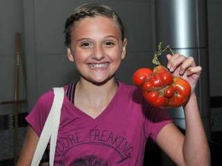 Annalise Capasso holds up her prize-winning entry for
