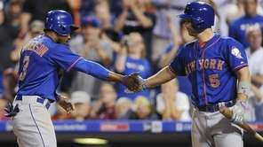 New York Mets' Curtis Granderson celebrates with David