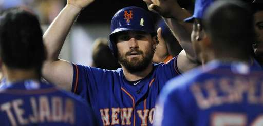 New York Mets' Daniel Murphy celebrates in the