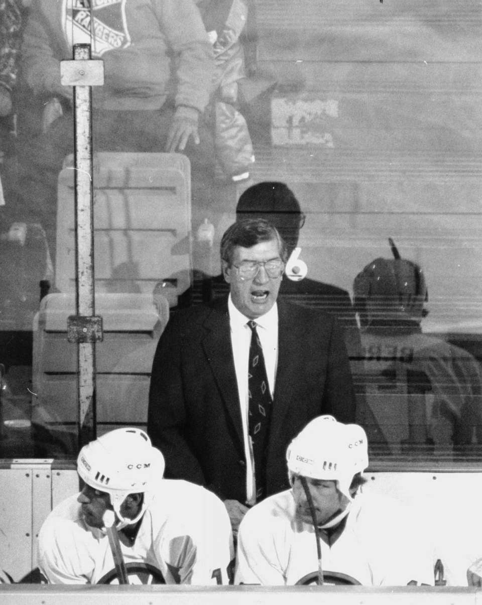 Al Arbour behind the bench of the New