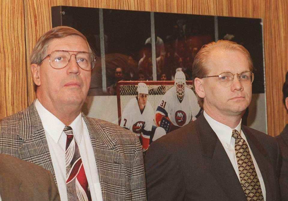 Al Arbour, left, and Darcy Regier at the