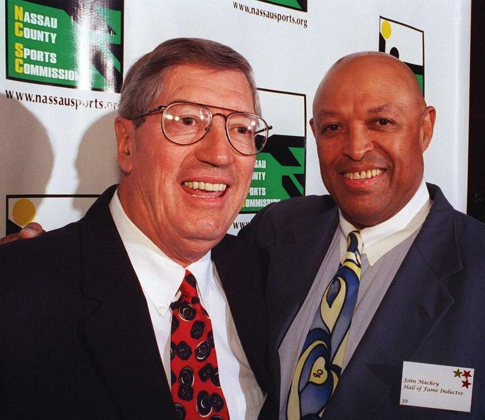 Al Arbour, left, and John Mackey, two of