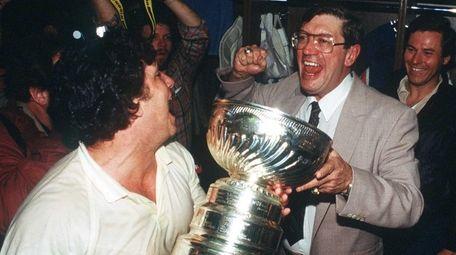 Islanders head coach Al Arbour, right, celebrates the
