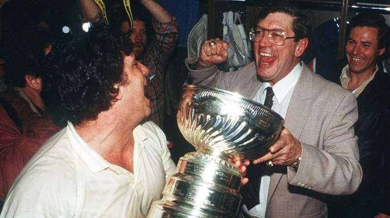 Islanders head coach Al Arbour, right, celebrates the