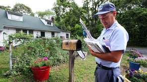 Postal carrier Elvis Velazquez, named after Elvis Presley,