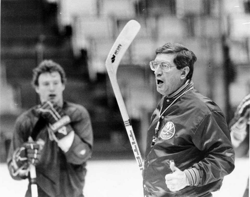 Islanders coach Al Arbour looks on during a