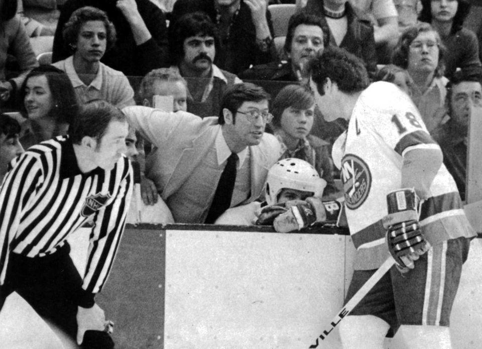 Islanders coach Al Arbour talks to Ed Westfall