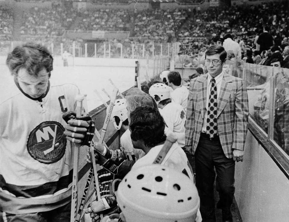 Al Arbour paces behind the bench during a