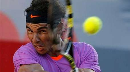 Rafael Nadal returns the ball to Horacio Zeballos