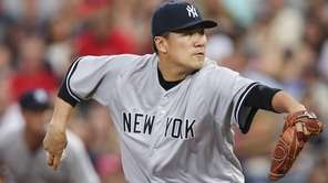 New York Yankees starting pitcher Masahiro Tanaka works