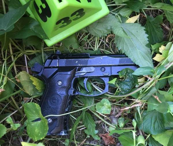 The NYPD said a replica weapon carried by