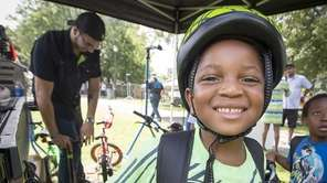 Marc Hardy, 5, smiles after receiving a free