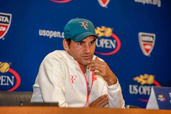 Roger Federer speaks to the media at the