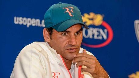 Roger Federer speaks to the media at the