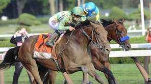 Keen Ice, with jockey Javier Castellano, moves past